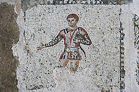 Detail of a mosaic depicting a man in the Villa of the Aviary, Carthage, Tunisia, pictured on January 27, 2008, in the afternoon. Carthage was founded in 814 BC by the Phoenicians who fought three Punic Wars against the Romans over this immensely important Mediterranean harbour. The Romans finally conquered the city in 146 BC. Subsequently it was conquered by the Vandals and the Byzantine Empire. Today it is a UNESCO World Heritage. The Roman Villa of the Aviary, with its octagonal garden set in a peristyle courtyard, is known for its fine mosaics depicting birds. Picture by Manuel Cohen.