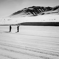 Two Danish soldiers who are stationed at Mestervig wave farewell to visitors. Mestersvig is a military outpost with a runaway in the Scoresby Land region of the Northeast Greenland National Park. Originally built in anticipation of mining in the area it has been run by the Danish defence department since 1988. The place is staffed by two men whose duties include maintenance of buildings and the airfield and support of other activities in the area.