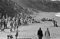 The crowd on the beach and on the cliffs at Bells Beach watching the running of the 1976 Bells beach Easter Rally won by Jeff hackman (HAW), Bells Beach, Torquay, Victoria, Australia. Photo: joliphotos.com