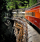 A train crossing a wooden bridge