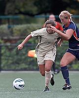 Boston College forward Stephanie McCaffrey (9) dribbles as Pepperdine University defender Mandy Davis (7) pressures. Pepperdine University defeated Boston College,1-0, at Soldiers Field Soccer Stadium, on September 29, 2012.