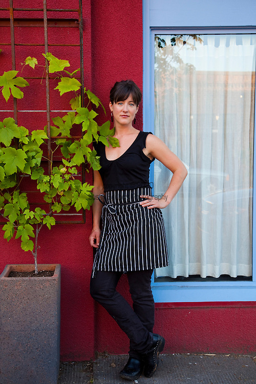 """Beast is a six-course, prix fixe restaurant in NE Portland, Oregon whose menu changes every Wednesday.  Chef Naomi Pomeroy (and single mom) and partner Micah Paredes focus on local ingredients in a style which they call """"refined French grandmother.""""  Pictured is Naomi Pomeroy standing in front of her restaurant."""