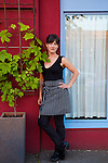 "Beast is a six-course, prix fixe restaurant in NE Portland, Oregon whose menu changes every Wednesday.  Chef Naomi Pomeroy (and single mom) and partner Micah Paredes focus on local ingredients in a style which they call ""refined French grandmother.""  Pictured is Naomi Pomeroy standing in front of her restaurant."