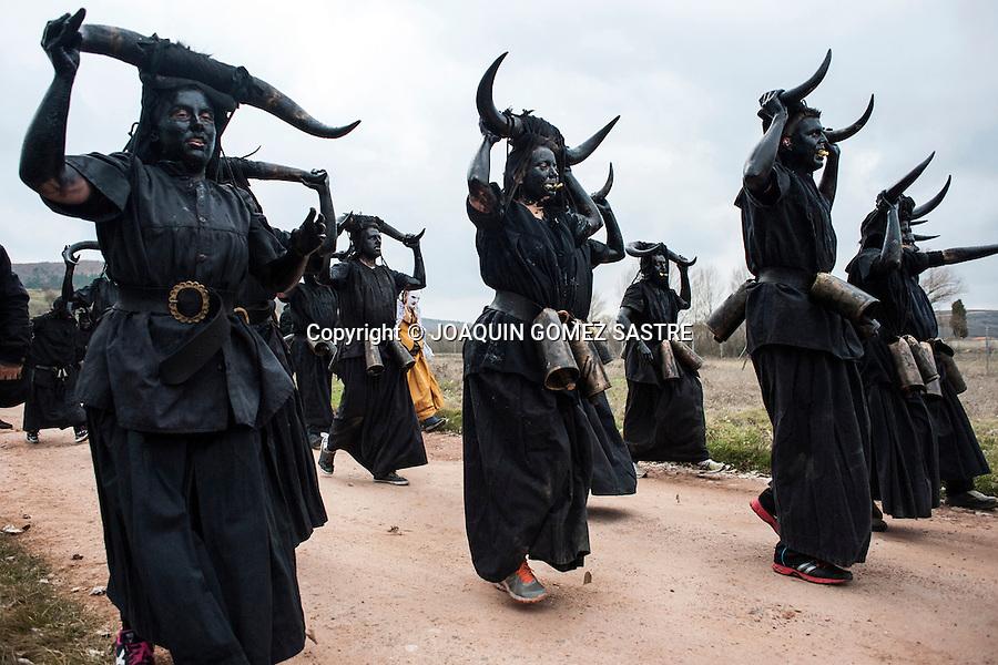 Devils lead the people of Luzon (Guadalajara) shaking their bells