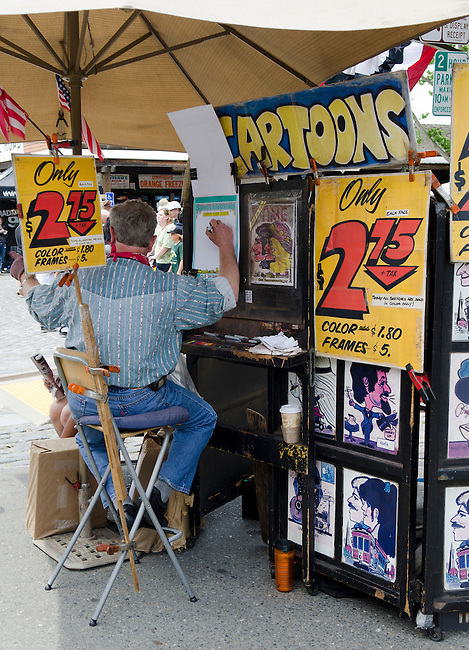 Sacramento CA, Old Town cartton artists draws caricature portraits of tourists.