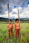 Yanomamo tribesmen hold spears, Parima Tapirapeco National Park, Venezuela