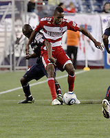 New England Revolution midfielder Sainey Nyassi (14) tackles FC Dallas midfielder/forward Atiba Harris(16) .  The New England Revolution drew FC Dallas 1-1, at Gillette Stadium on May 1, 2010