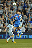 Andrea Romero (15) forward Montreal Impact goes up for a header with Matt Besler (5) defender Sporting KC..Sporting Kansas City defeated Montreal Impact 2-0 at Sporting Park, Kansas City, Kansas.