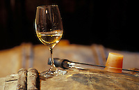 glass of Chablis in the cellars of Bernard Raveneau - Photograph by Owen Franken