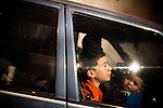 A Guatemalan family drives past a crime scene where police, military, and firefighters investigate a homicide of four drug gangs dealers who were shot and killed, in Zone 10, in Mixco, Guatemala, on Saturday, Nov. 5, 2011. <br /> <br /> Mixco is a transit point for drug traffickers, including the ruthless Los Zetas Mexican drug cartel. In the past three years, Guatemala has seen a rise in Mexico drug gangs because of the major anti-drug operations launched by Mexican President Felipe Calderon, and because of its porous borders, drug gangs can easily transit drugs from Colombia through Mexico and into the United States.
