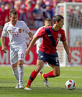 USA defender   Eric Lichaj (14) looks to pass as Spain midfielder Santiago Cazorla (20) defends. In a friendly match, Spain defeated USA, 4-0, at Gillette Stadium on June 4, 2011.