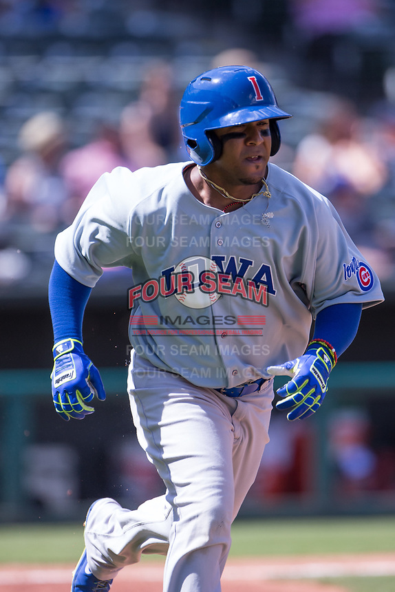 Ozzie Martinez (28) of the Iowa Cubs heads to first base after hitting the ball during a game against the Oklahoma City Dodgers at Chickasaw Bricktown Ballpark on April 9, 2016 in Oklahoma City, Oklahoma.  Oklahoma City defeated Iowa 12-1 (William Purnell/Four Seam Images)