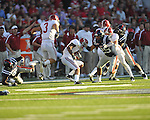Alabama wide receiver Marquis Maze (4) is tackled by Ole Miss' Cody Prewitt (25) at Vaught-Hemingway Stadium in Oxford, Miss. on Saturday, October 14, 2011. Alabama won 52-7.
