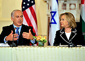 "Prime Minister Benjamin Netanyahu of Israel makes remarks as United States Secretary of State Hillary Rodham Clinton listens at the ""Relaunch of Direct Negotiations Between the Israelis and Palestinians"" in the Benjamin Franklin Room of the U.S. Department of State on Thursday, September 2, 2010.  .Credit: Ron Sachs / CNP.(RESTRICTION: NO New York or New Jersey Newspapers or newspapers within a 75 mile radius of New York City)"