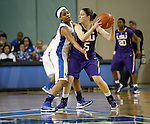 UK guard Bria Goss defends LSU guard Jeanne Kenney during the first half of the women's basketball game vs. LSU Memorial Coliseum , in Lexington, Ky., on Sunday, January 27, 2013. Photo by Genevieve Adams  | Staff.