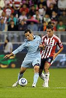 Omar Bravo (99) Sporting KC holds off the challenge from Arturo  Ledesma (3) Chivas Guadalajara... Sporting Kansas City and Chivas Guadalajara played to a 2-2 tie in an international friendly at LIVESTRONG Sporting Park, Kansas City, Kansas.