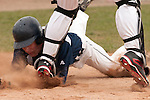 New Plymouth's Lee Massey slides safely into home as Vale catcher Derrek Rodriguez goes on his tiptoes to catch the ball. Massey scored New Plymouth's first run at Vale High School's Cammann Field on April 28, 2011. Vale won 8-3.