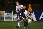 13 November 2009: Virginia's T.J. Cyrus (4) and Wake Forest's Luke Norman (14). The University of Virginia Cavaliers defeated the Wake Forest University Demon Deacons 4-3 on penalty kicks after the game ended in a 0-0 tie after overtime at WakeMed Stadium in Cary, North Carolina in an Atlantic Coast Conference Men's Soccer Tournament Semifinal game.