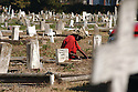 A grave digger at Holt Cemetery, 2003
