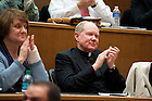 November 18, 2011; Rev. Timothy Scully, C.S.C., director of Institute for Educational Initiatives; Professor, applauds at the close of New Jersey Gov. Chris Christie's keynote address during a daylong symposium, titled &ldquo;Educational Innovation and the Law&rdquo; in the Patrick F. McCartan Courtroom at the Notre Dame Law School. Photo by Barbara Johnston/University of Notre Dame.