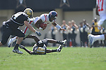 Ole Miss quarterback Randall Mackey (1) is tackled by Vanderbilt safety Sean Richardson (21) and Vanderbilt defensive tackle T.J. Greenstone (74) in Nashville, Tenn. on Saturday, September 17, 2011. Vanderbilt won 30-7..