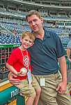 9 June 2013: Washington Nationals Director of Media Relations Mike Gazda (right) poses with his 4 year old son Josh at the dugout fence prior to a game against the Minnesota Twins at Nationals Park in Washington, DC. The Nationals shut out the Twins 7-0 in the first game of their day/night double-header. Mandatory Credit: Ed Wolfstein Photo *** RAW (NEF) Image File Available ***