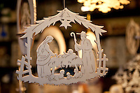 Wooden carved hanging ornaments at Christmas market, Winter Wonderland, in Hyde Park, London