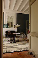 The mirror above the fireplace in the small salon has an ornate stucco surround