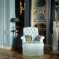 Pale duck egg blue upholstery, blue-and-white porcelain and gilding combine to create this stunning corner of a New York apartment