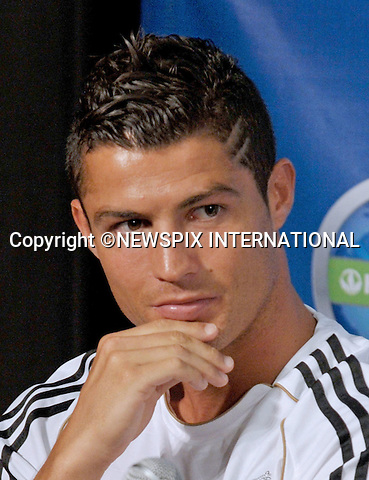 """CRISTIANO RONALDO.at the Herbalife World Football Challenge Superstar Press Conference at Creative Artists Agency's Ray Kurtzman Theatre, Century City, California_12/07/2011.Mandatory Photo Credit: ©Crosby/Newspix International. .**ALL FEES PAYABLE TO: """"NEWSPIX INTERNATIONAL""""**..PHOTO CREDIT MANDATORY!!: NEWSPIX INTERNATIONAL(Failure to credit will incur a surcharge of 100% of reproduction fees).IMMEDIATE CONFIRMATION OF USAGE REQUIRED:.Newspix International, 31 Chinnery Hill, Bishop's Stortford, ENGLAND CM23 3PS.Tel:+441279 324672  ; Fax: +441279656877.Mobile:  0777568 1153.e-mail: info@newspixinternational.co.uk"""
