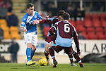 St Johnstone v Stenhousemuir&hellip;21.01.17  McDiarmid Park  Scottish Cup<br />Danny Swanson gets between Vincent Berry and<br />Picture by Graeme Hart.<br />Copyright Perthshire Picture Agency<br />Tel: 01738 623350  Mobile: 07990 594431