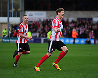 Lincoln City's Sean Raggett celebrates scoring the opening goal <br /> <br /> Photographer Andrew Vaughan/CameraSport<br /> <br /> Buildbase FA Trophy Semi Final Second Leg - Lincoln City v York City - Saturday 18th March 2017 - Sincil Bank - Lincoln<br />  <br /> World Copyright &copy; 2017 CameraSport. All rights reserved. 43 Linden Ave. Countesthorpe. Leicester. England. LE8 5PG - Tel: +44 (0) 116 277 4147 - admin@camerasport.com - www.camerasport.com