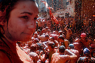People throw and splash tomato pulp during La Tomatina festival in Bunol, Spain, 31 August 2006. La Tomatina is a tomato fight held annually in the town of Bunol, close to Valencia. Approximately 40,000 people from all over the world arrive to fight in the battle in which about 50 tons of over-ripe tomatoes are thrown in the street. During the one hour battle everybody fights everybody by throwing squashed tomatoes. The origin of this event is unknown but the Tomatina fights have been recorded since 1945.
