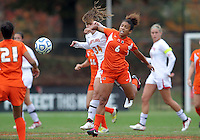 COLLEGE PARK, MD - OCTOBER 28, 2012:  Danielle Hubka (34) of the University of Maryland clashes with Jordan Roseboro (6) of Miami during an ACC  women's tournament 1st. round match at Ludwig Field in College Park, MD. on October 28. Maryland won 2-1 on a golden goal in extra time.