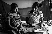 Mathumita (right) shares the various information with Tuvarny, 10 month pregnant expecting woman as part of the pre-natal programme during the field visits in Punaineeravi village in Kilinochchi in Northern Sri Lanka. Photo: Sanjit Das/Panos