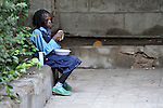 A refugee girl eats lunch in a school operated by St. Andrew's Refugee Services in Cairo, Egypt. The school is supported by Church World Service.