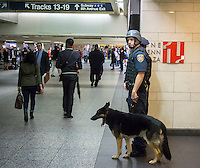 Very visible K-9 officer patrols Pennsylvania Station in New York on Thursday, September 25, 2014 in response to Iraqi Prime Minister Haider al-Abadi's report of an imminent ISIS terrorist plot on the New York and Paris subway systems. Law enforcement and intel agencies are reporting that they know of no plot and the police in New York have been operating at heightened security level already. (© Richard B. Levine)