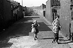 Children playing in the back lane, back to back housing. South Kirkby Colliery, Yorkshire England. Coal Miners story 1979.