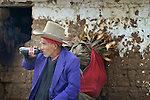 A man drinks soda in Tuixcajchis, a small Mam-speaking Maya village in Comitancillo, Guatemala.