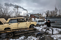 A young migrant worker walks through a scrapyard on the outskirts of Astana on the right bank of the Ishim River where much of the city still resembles the Soviet era provincial town from which it was born.