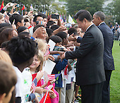 United States President Barack Obama and President XI Jinping of China participate in an arrival ceremony during an official State Visit on the South Lawn of the White House in Washington, DC on Friday, September 25, 2015.<br /> Credit: Chris Kleponis / Pool via CNP