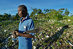 Abel Dupres stands in his farm field early in the morning in Despagne, a rural village in southern Haiti where the Lutheran World Federation has been working with residents to improve their quality of life.