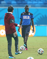Mario Balotelli of Italy laughs during training ahead of tomorrow's Group D match vs Uruguay