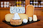 Foster and Dobbs, in a neighborhood in NE Portland, Oregon.  A variety of cheeses that the store carries including: Pleasant Ridge Reserve, Blu du Bocage, L'amuse, brewleggio, corsica brebichon, Le Picandon, Tomme du Berger and Cape Foulweather.