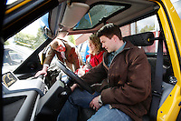 Potential clients is being shown the electric car Kewet Buddy, which is being produced at a factory in Oslo, Norway, by ElBil Norge AS (Ltd.) . Fully charged the car can run for about 80 km on flat terrain. Though considered a car by most people, the vehicle actually has to be registered as a motorcycle.© Fredrik Naumann