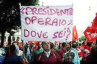 """Roma Maggio 2004.Manifestazione degli operai della Fiat di Melfi.""""Presidente Operaio dove sei?"""".Demonstration of workers at Fiat Melfi .The banners """"President worker where are you?"""" (Berlusconi)"""