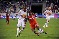 Danleigh Borman (25) of Toronto FC clears the ball away from Dane Richards (19) of the New York Red Bulls. The New York Red Bulls defeated Toronto FC 5-0 during a Major League Soccer (MLS) match at Red Bull Arena in Harrison, NJ, on July 06, 2011.