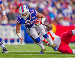 9 November 2014: Buffalo Bills running back Fred Jackson is tackled by Kansas City Chiefs defensive end Allen Bailey in the third quarter at Ralph Wilson Stadium in Orchard Park, NY. The Chiefs rallied with two fourth quarter touchdowns to defeat the Bills 17-13. Mandatory Credit: Ed Wolfstein Photo *** RAW (NEF) Image File Available ***