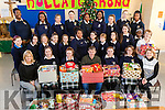Pictured are Presentation Secondary School who represent the students council presenting the Christmas Food Appeal collection in aid of St. Vincent De Paul, to Junior Locke on Friday morning last.