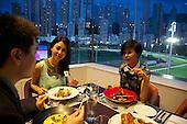 Guests enjoy dinner at the Hong Kong Jockey Club.